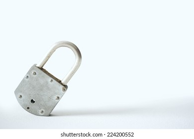 Metal padlock tilted to one side, close-up