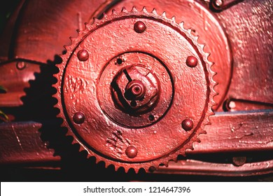Metal painted part of unidentified old engine in sun light