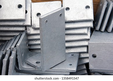 Metal parts for mounting structures with a galvanized coating. Metalworking with electroplating protects the metal from corrosion.