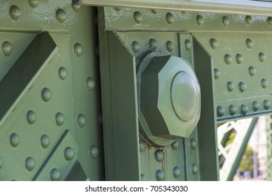 Metal parts of the rivet joints and bolts of the bridge construction
