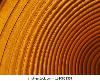 Metal pattern of round tracks and furrows. Abstract modern technology, industry, design, engineering or architecture background. Minimalist geometric compostion of concentric circles in golden color.
