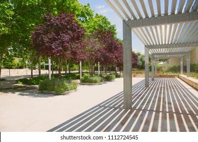 Metal pergola in green park
