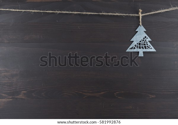 Metal Pine Tree Ornament Hanging From Twine