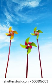 metal pinwheels with blue sky background