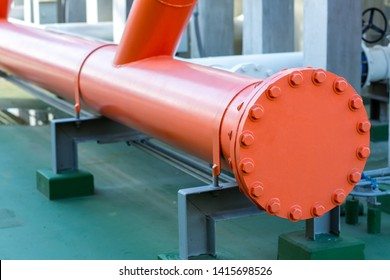 A metal pipe with a blank flange shutting off the end. Water steel Flange Pipe Fitting The blind flange is installed at the end of the pipe system with a pipe support.