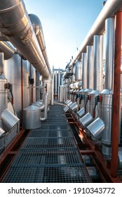 Metal pipes for ventilation on rooftop in a bright sky