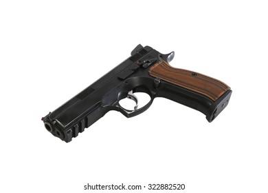 Metal pistol gun laying on white background
