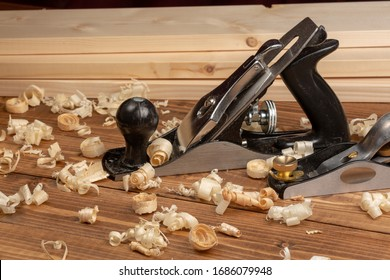 Metal planer with wood shavings. Carpenter cabinet maker hand tools on the workbench.