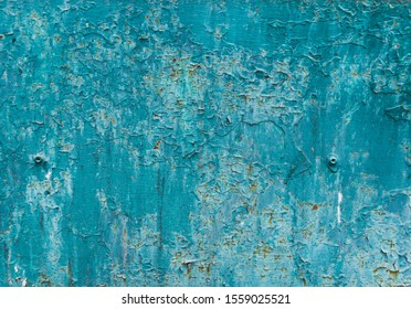 Metal plate with cracked blue paint and rust. Old background