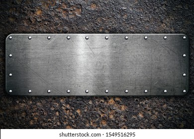 Metal plate on rusty steel background