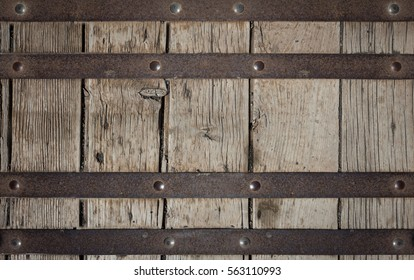 Metal plate with screws over the wooden background