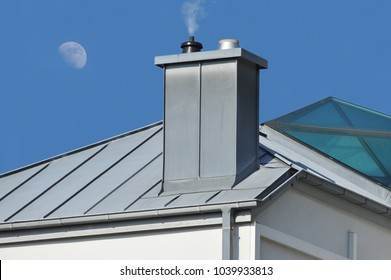 Metal plated Chimney at a Standing Seam Metal- and Glass Roof