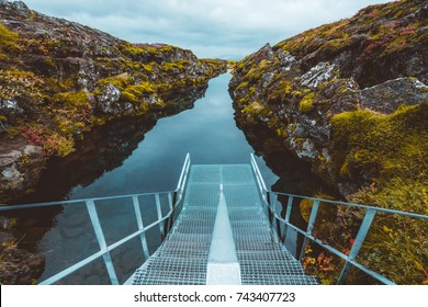 Metal platform at Silfra rift filled with water, Iceland