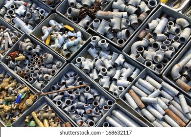 Metal plumbing pipe fittings piled up in the box  in a market