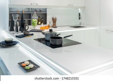 Metal Pot and frying pan on induction hob in modern kitchen. modern kitchen pot cooking induction electrical stove hob concept