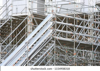 metal prefabricated structures / abstract background metal beams and pipes in prefabricated industrial structures, construction of temporary structures
