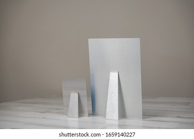 Metal print photography product with kickstand - back view. Shot on isolated white and gray background with blank empty room space for text or copy.