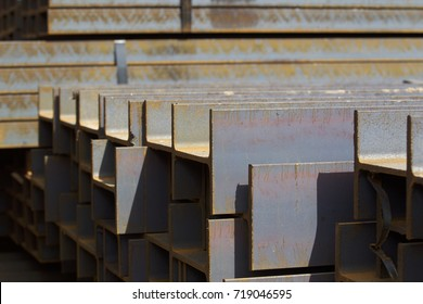 Metal profile beam in packs at the warehouse of metal products