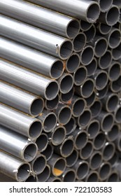 Metal profile pipe of round section in packs at the warehouse of metal products, Russia