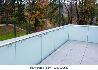Metal railings and glass wall