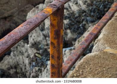 Metal railings ravaged by salt water