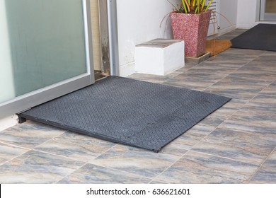 metal ramp way for support wheelchair disabled people in front of sliding door