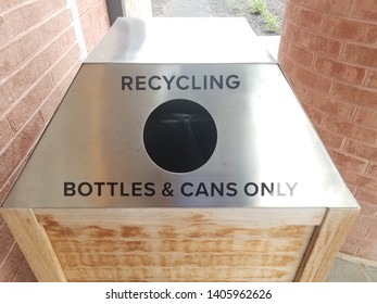 metal recycling bottles and cans only sign with hole
