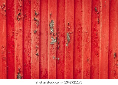 metal red fence with debris and scuffs is the fashion trend of today for building design