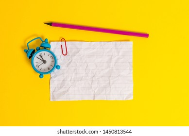 Metal retro vintage alarm clock wakeup clip crushed sheet note pencil lying colored background empty text important events what to do office school home