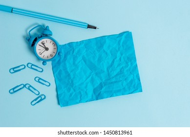 Metal retro vintage alarm clock wakeup blank crushed sheet note marker clips colored background all in same sky color Empty text important events school house office