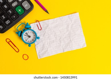Metal retro vintage alarm clock wakeup clips crushed sheet note rubber band calculator pencil lying colored background empty text important events what to do office school home