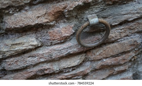 metal ring fixed on brick wall