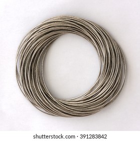 Metal rings twisted together on a white background