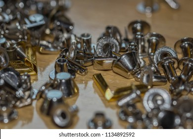 Metal rivets and studs laying on a work table for DIY projects, seweing leather, denim.