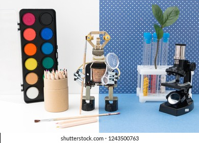 Metal robot with a brush in his hand. Stem plus art is equal to STEAM. Science, technology, engineering, art, mathematics. Concept of new methods of teaching children and teenagers.