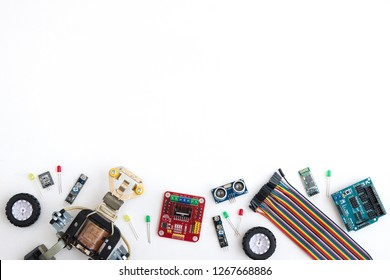 A metal robot and an electronic board that can be programmed. Robotics and electronics. DIY robotics. Mathematics, engineering, science, technology, computer code. STEM and STEAM education for kids.