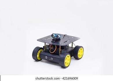 metal robot on wheels on white background