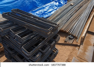 Metal rods. Preparatory work before concreting. Rebars for reinforced concrete. Steel reinforcement bar texture in construction site.