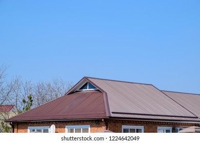 Metal roof brown. Construction of houses and types of roofing