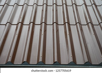 Metal roof  of a brown home background.