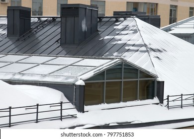 Metal roof covered by snow