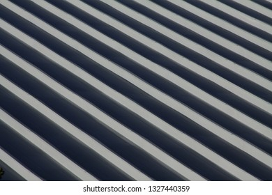 Metal roof design on commercial building.