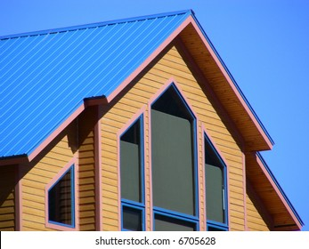 Metal roof and picture windows in a mountain home