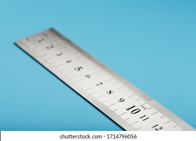 Metal ruler on a blue background close-up with a copy of the space for your text.