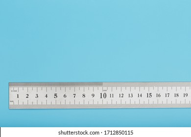 A metal ruler with a scale on a blue background is a superscape with a copy of the space for your text.