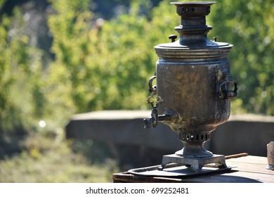 Metal samovar on a background of green tea drinking