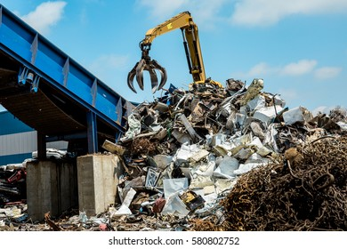 Metal scrap yard machine and scrap pile