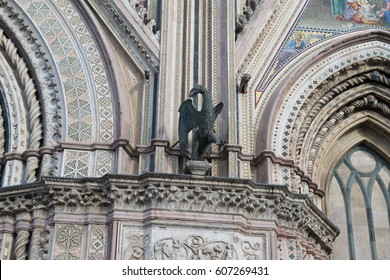 Metal sculpture on the front facade of the Orvieto Cathedral, Italy