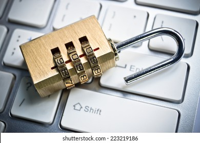metal security lock with password on computer keyboard - security concept in computer