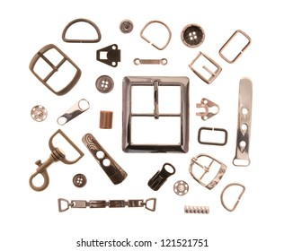 The metal sewing fittings are on white background.